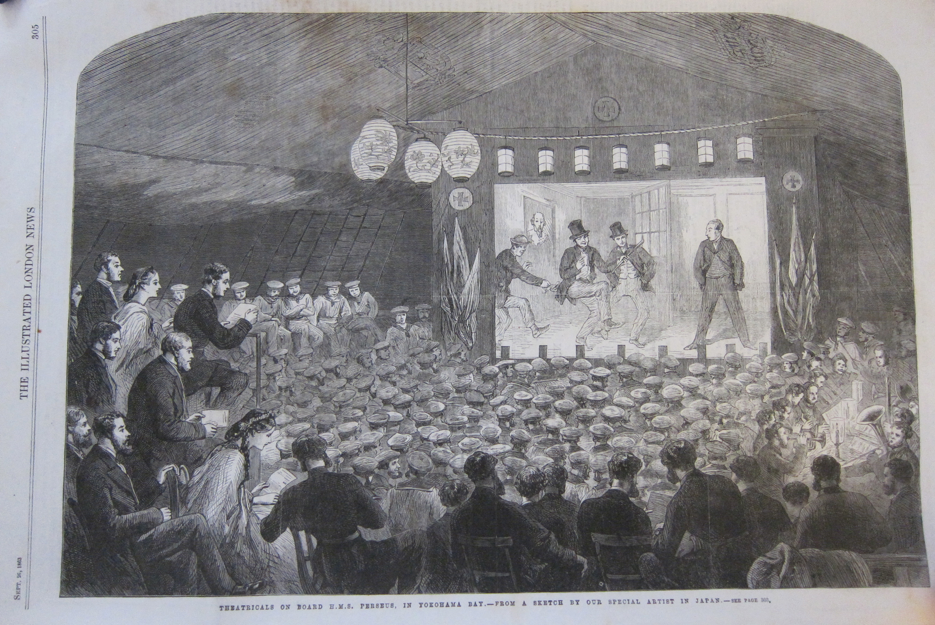 A performance on the upper deck of HMS Perseus. Sailors on a makeshift stage performing for a crowd of bluejackets, invited guests, and officers.